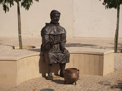 Statue of a monk and stone soup (sopa da pedra) in Almeirim, Portugal