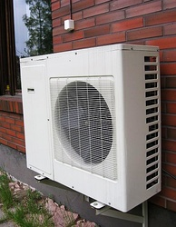 An example of an externally fitted AC unit which uses a heat pump system