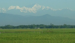 The fertile Bangladesh Plain seen against the backdrop of the Himalayas