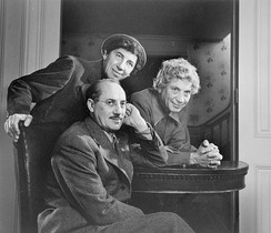 The Marx Brothers (clockwise: Groucho, Chico, and Harpo) by Yousuf Karsh in 1948