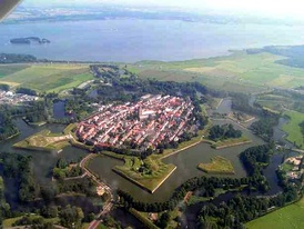 The 17th-century fortified town of Naarden, Netherlands, showing bastions projecting into the wet moat
