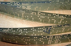 In the 1950s, computer programs were stored on perforated paper tape