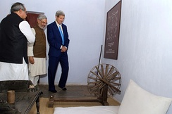 Mohandas Gandhi's bedroom, bed, desk, and spinning wheel in the Sabarmati Ashram