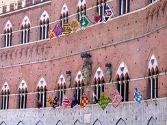 Façade of the Palazzo Pubblico (town hall) during the Palio days.