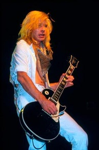 "Steve ""Steaming"" Clark, lead guitarist of Def Leppard. Extended virtuoso guitar solos were a characteristic of heavy metal music in the 1980s.[184]"