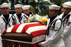 Sailors from a US Navy honor guard carry Navy pilot Scott Speicher's remains.