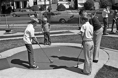 Boys playing miniature golf in Alameda County, California, 1963