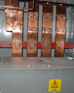 Copper electrical busbars distributing power to a large building