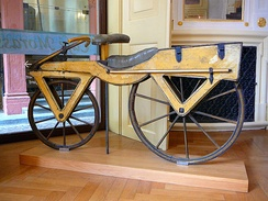 Wooden draisine (around 1820), the first two-wheeler and as such the archetype of the bicycle