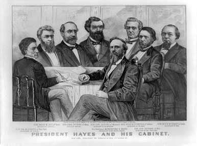 The Hayes Cabinet in 1877; Sherman is seated directly behind Hayes.