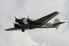 "Lufthansa's 21st-century airworthy heritage Ju 52/3mg2e (Wk-Nr 5489) in flight, showing the Doppelflügel, ""double wing"" trailing-edge control surfaces"
