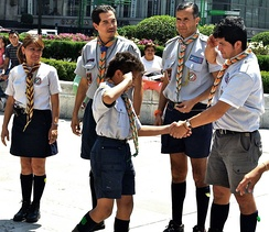 Leaders welcome a boy into Scouting, March 2010, Mexico City, Mexico.