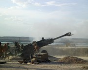 Canadian soldiers fire an M777 at Taliban fighting positions from a forward operating base in the Helmand Province