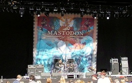 A Mastodon backdrop in 2006, showcasing an elaborate painting, using the Leviathan artwork by the painter Paul Romano