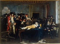 Lying on a table, wounded, in a room of the convention, Robespierre is the object of the curiosity and quips of Thermidorians, painting by Lucien-Étienne Mélingue (Salon de 1877)(Musée de la Révolution française)