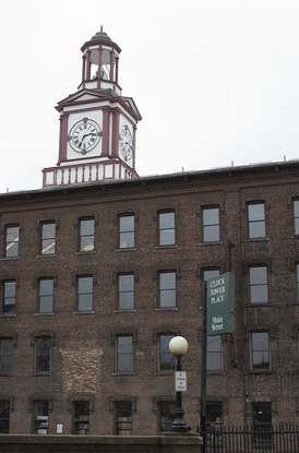 Clock Tower, completed 1892, seen from Main Street. An image of the Clock Tower is incorporated into the Town Seal, displayed on street signs and town vehicles.
