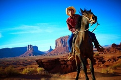 A Navajo man on horseback in Monument valley, Arizona, United States