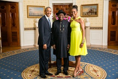 Former Nigerian President Goodluck Jonathan (center) poses with United States President Barack Obama and First Lady Michelle Obama in August 2014