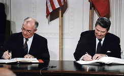 Soviet General Secretary Gorbachev and U.S. President Reagan signing the INF Treaty, 1987