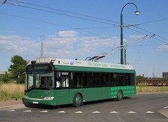 A trolleybus uses two overhead wires to provide electric current supply and return to the power source