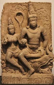 Varuna with Varunani. Statue carved out of basalt, dates back to 8th century CE, discovered in Karnataka. On display at the Prince of Wales museum, Mumbai.