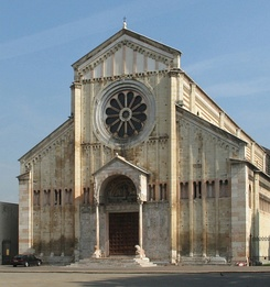 Church of San Zeno, Verona, Italy, The facade is neatly divided vertically and horizontally. The central wheel window and small porch with columns resting on crouching lions is typical of Italy.