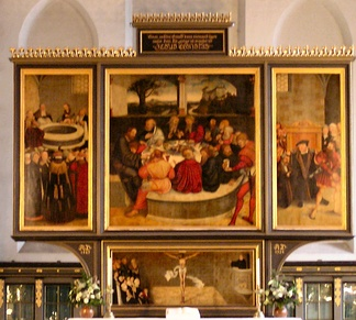 Cranach the Elder's Altarpiece at Wittenberg. An early Lutheran work depicting leading Reformers as Apostles at the Last Supper.