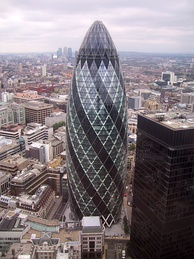 View of 30 St Mary Axe. The building serves as the London headquarters for Swiss Re and is informally known as 'The Gherkin'.