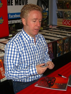 Millar signing a copy of Superman: Red Son
