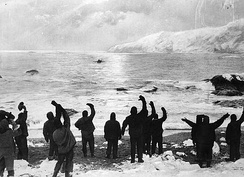 """All Safe, All Well"", allegedly depicting Shackleton's return to Elephant Island, August 1916. A photograph of the departure of the James Caird in April was doctored by photographer Frank Hurley to create this image.[106]"