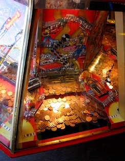 A pusher game, with both coins and small prizes available to win