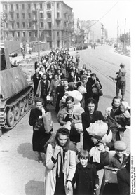 A column of Polish civilians being led by German troops through Wolska Street in early August 1944.