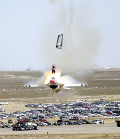 Captain Chris Stricklin ejects from his F-16 at the Mountain Home AFB airshow on 14 September 2003.