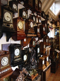 Antique cuckoo clocks in the interior of Cuckooland Museum.