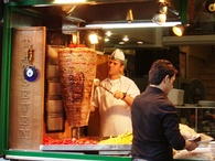 Döner kebab being sliced.
