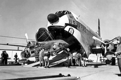 An F-104A Starfighter interceptor from the 157th Fighter-Interceptor Squadron, South Carolina Air National Guard, is loaded aboard a C-124 Globemaster II for shipment to Europe during the Berlin crisis, 1961.