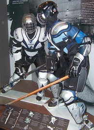 Models with the protective equipment worn by ice hockey skaters; such as a helmet, shoulder pads, elbow pads, gloves, hockey pants, and shin guards.