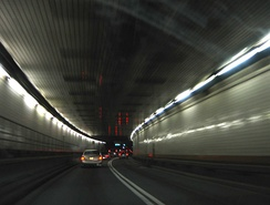 Traveling through the Holland Tunnel, from Manhattan to Jersey City, New Jersey.