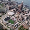 Cleveland with Progressive Field and Quicken Loans Arena in the foreground with Cleveland Browns Stadium in the background.
