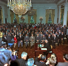United States President Lyndon B. Johnson speaks to a television camera at the signing of the Civil Rights Act in 1964