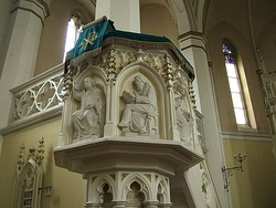 Key figures of the Protestant Reformation: Martin Luther and John Calvin depicted on a church pulpit. These reformers emphasised preaching and made it a centerpiece of worship.