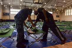 Morale, Welfare and Recreation employees assembling and checking emergency preparation kits in Joint Base Pearl Harbor–Hickam in advance of Hurricane Lane