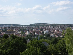 "View from the southeast (gardens on the lower slopes of Burgholzhof) of the core area of the modern city district of Zuffenhausen. The towers of St. Paul (left) and St. John's Church in the ""Old Patch"" (right) are visible."
