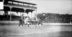 Fielder Jones of the White Sox hits the ball against Cubs at West Side Grounds, 1905