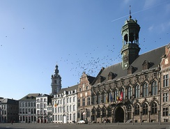 The central square and town hall of Mons with the belfry in the background