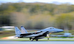 The 19th Fighter Squadron's F-15 Eagle flagship takes off for the final time at Elmendorf Air Force Base, Alaska, 13 May 2010