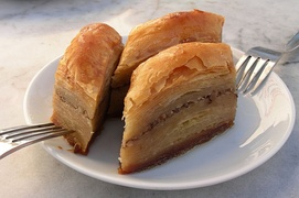 Baklava, a pastry comprising layers of filo with chopped nuts, sweetened and held together with syrup or honey