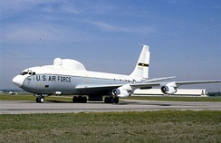The Airborne Laser Lab was a gas-dynamic laser mounted in a modified version of a KC-135 used for flight testing. Similar to the commercial Boeing 707, the slightly smaller KC-135 was designed to military specifications and operated at high gross weights. The NKC-135A (S/N 55-3123) was extensively modified by the Air Force weapons Laboratory, and used in an 11-year experiment to prove a high-energy laser could be operated in an aircraft and employed against airborne targets.