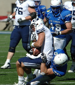 A BYU quarterback being sacked by Air Force.