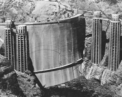 The upstream face of Hoover Dam slowly disappears as Lake Mead fills, May 1935 (looking downstream from the Arizona rim)